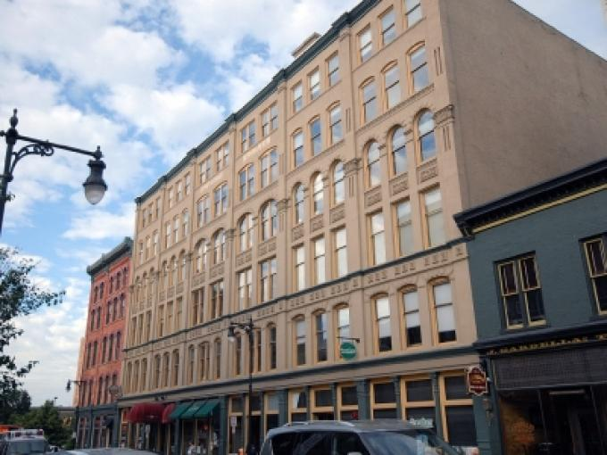 Lansing real estate firm buys historic downtown grand for Grand rapids architecture firms