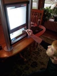 Vizidef co-owner Justin Verberg demonstrates one of the Grand Rapids-based company's interactive displays.