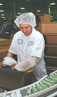 A worker packs energy bars for shipment at Elan Nutrition, which was acquired by ConAgra in 2010. The company recently announced that it planned to close the Kentwood plant by next year.