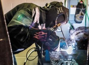 The Muskegon Area Career Technical Center, above and lower left, aims to get students to interact with local businesses to help determine what career path they want to take. The center offers training in a range of manufacturing fields, as well as in health care and criminal justice.
