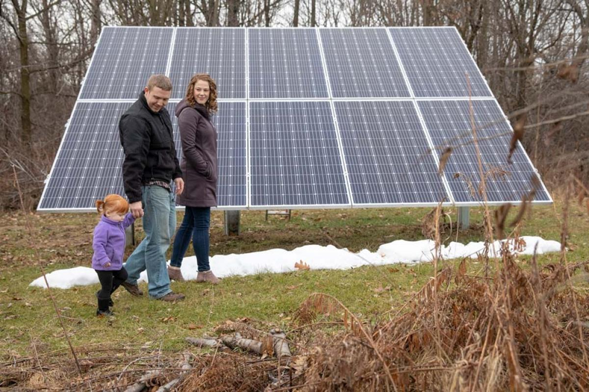 Chris and Marla Drury, pictured with daughter Evelyn, financed a 3.6 kilowatt residential solar project in Alma through the Michigan Saves program.