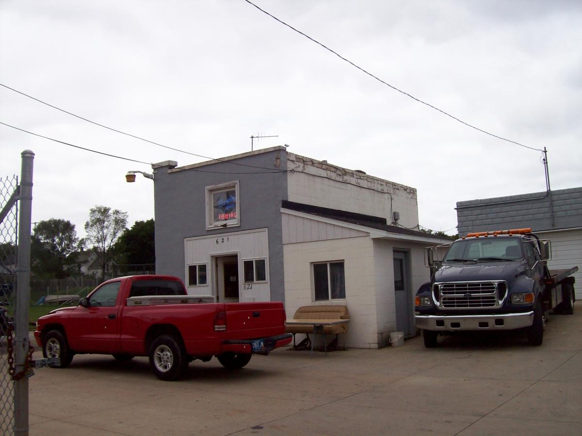 The proposed project involves the construction of a four-story building and three two-story structures to create a 70-unit affordable rental development, located on Eastern Avenue between Sherman Street and Thomas Street at the current site of Brother Love's Towing LLC (pictured).