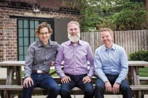 Software development firm Atomic Object LLC recently transitioned to a new leadership structure with Shawn Crowley, left, and Mike Marsiglia, right, taking over as co-CEOs while founder Carl Erickson, center, became executive chairman.
