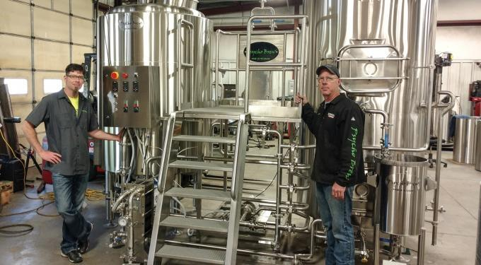 Greenville-based Psycho Brew co-founder Chris Breimayer, left, said the company has worked to generate business from the many small, neighborhood breweries that have opened recently. The majority of the company's sales are for 7-barrel brewing systems or smaller, he said.