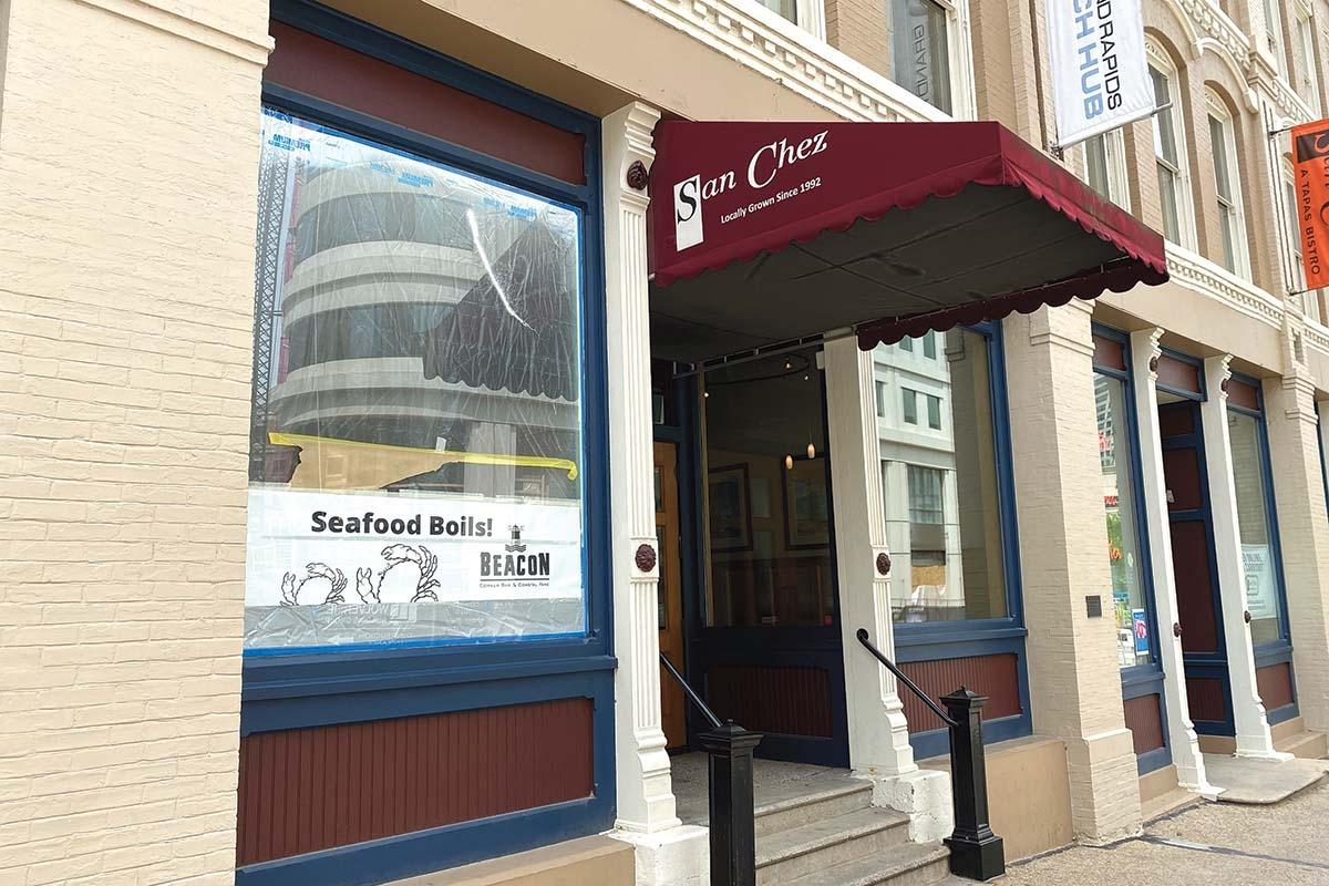 The pandemic caused San Chez, a longtime eatery in downtown Grand Rapids, to put plans on hold to open seafood boil concept Beacon in the same building as its legacy restaurant. The building also suffered some damage from the unrest over police brutality in late May.
