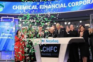 Chemical Financial Chairman, President and CEO David Ramaker rang the Nasdaq opening bell on March 14 to mark the bank's 100th anniversary. Director Emeritus Alan Ott, who led the bank when it went public in 1988, joined Ramaker in New York City for the occasion.