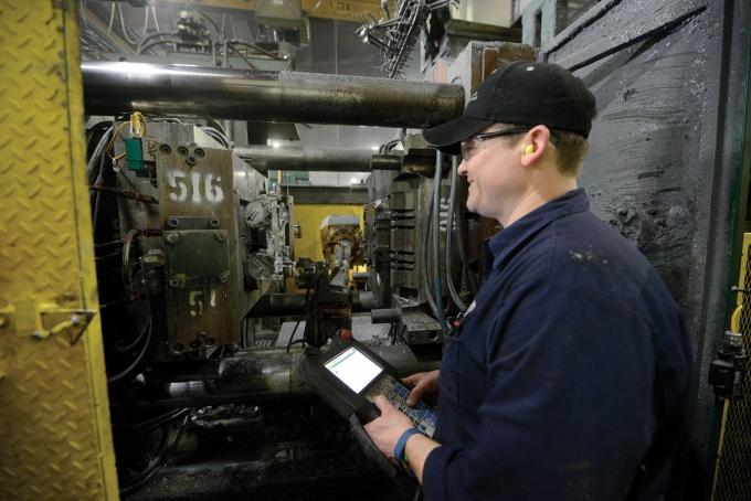 Cascade Die Casting received $14,000 in grants from the state's Skilled Trades Training Funds to support training at its plants in Grand Rapids and Sparta. David Finnila works on robotic equipment at the company's Sparta location.