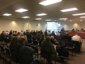 Developers of a proposed massive distribution center discuss their plans with the Gaines Township Planning Commission officials.
