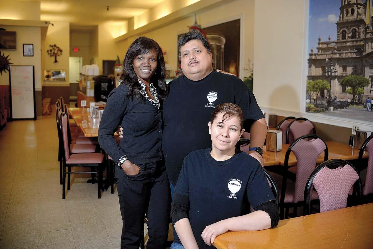 Pictured, from left: Transformando West Michigan Program Manager Ana Jose and El Globo Restaurant owners Oswaldo Cordova and Evangelina Abundis