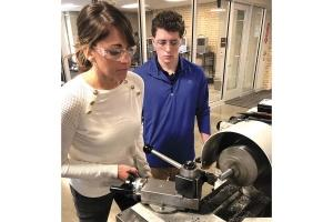 Sales team members from Creston Industrial Sales get hands-on training with machining equipment as part of a customized program the company developed with Grand Rapids Community College.