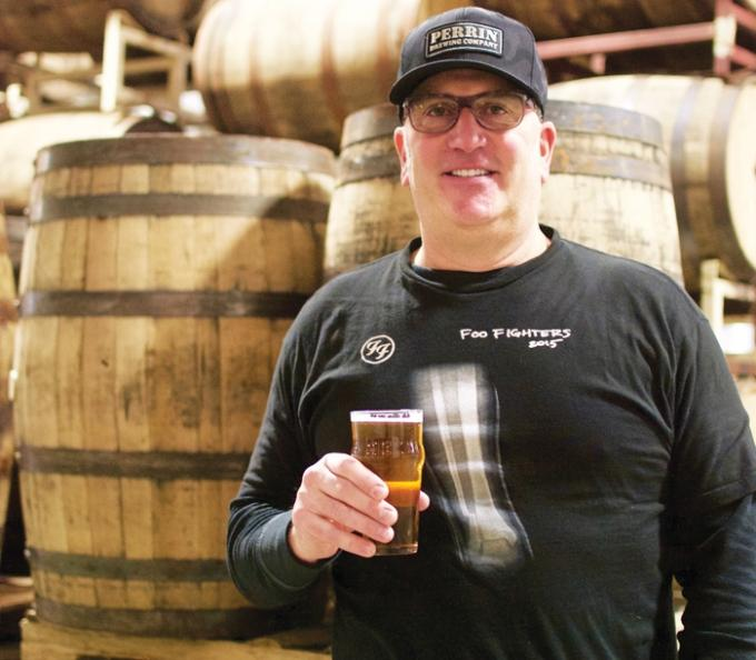Keith Klopcic says the deal he struck with Oskar Blues Brewery and Fireman Capital to buy Perrin Brewing Co. in Comstock Park has worked well, particularly because it's allowed him to continue scaling up the business. Perrin's beers, including new session IPA No Problems, are now available in cans across Michigan's Lower Peninsula, and the brewery continues to ramp up its bottled specialty releases, such as the prized No Rules Vietnamese Porter, which is aging in the bourbon barrels behind Klopcic ahead of a March release date.
