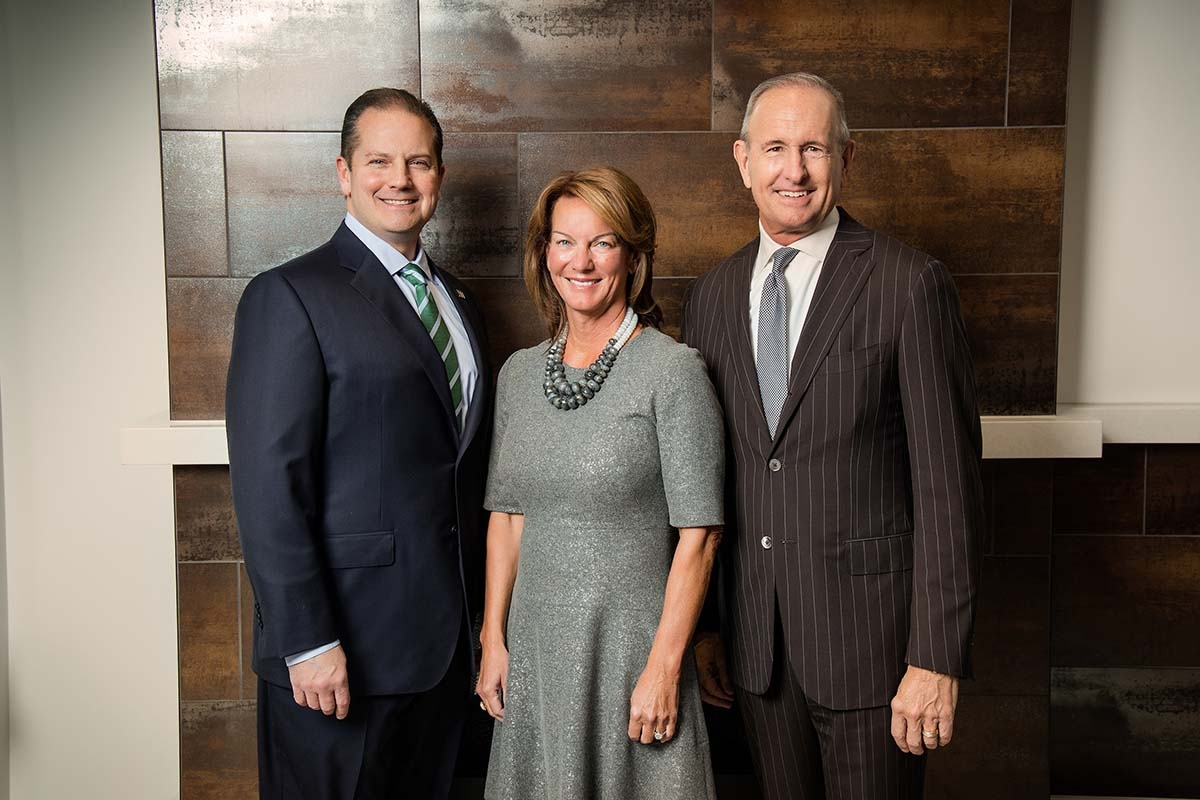 Left to right: Tom Welch, Carol Van Andel, and Dick DeVos