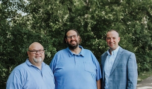 From left: ComForCare of Grand Rapids Co-Owner Bill McIntyre, and Michael Merren, with ChoiceOne Bank's Commerical Loan Officer, Aaron Griffin.