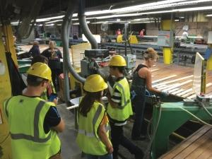 Workers at Amasa-based Connor Sports Flooring LLC in the Upper Peninsula produce wood flooring for basketball courts, tracks and other athletic applications.