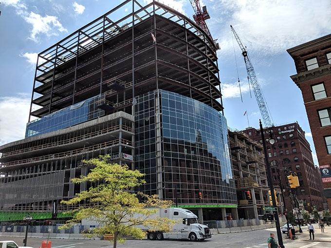 Orion Construction crews continue to make progress on the Warner Building in downtown Grand Rapids. The firm says rising material prices haven't caused any project delays so far.