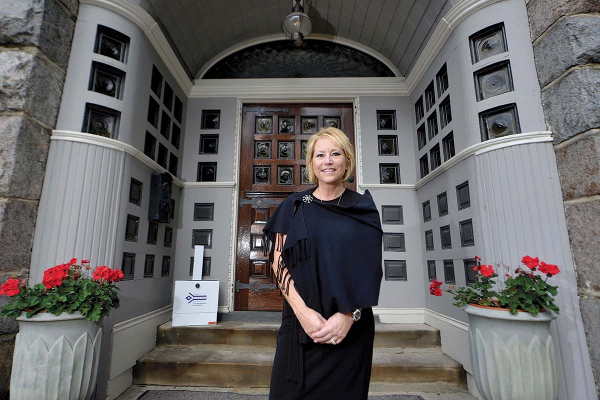 Sanford Addiction Treatment Centers President Rae Green stands in the entryway of the organization's men's substance use treatment center in Grand Rapids' Heritage Hill neighborhood. In recent years, the center has served a growing number of people battling opioid addiction.