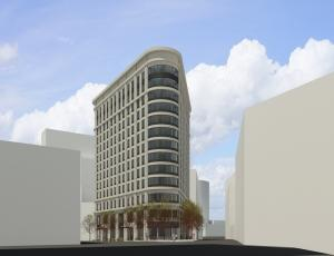 Hinman Co. is now proposing a 13-story development for a triangular lot bordered by Fulton Street, Louis Street and Ionia Avenue in downtown Grand Rapids. The company's original plans — announced in 2016 — included a 42-story tower at the site.