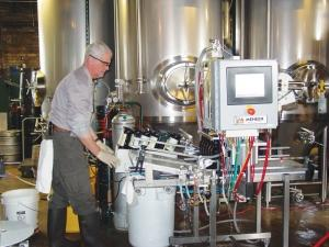 Nelson Tansey left a career in sales and engineering to launch JBT Bottling, a Kalamazoo-based company that offers a mobile bottling service to small and startup craft beverage producers, including breweries and cideries. JBT Bottling specializes in filling 22-ounce bottles on its Meheen system, but the company also operates a similar line to fill standard 12-ounce bottles.