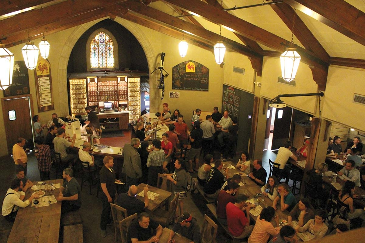 "Doing an acquisition is ""just not on our list of things to do,"" according to Brewery Vivant co-founder and CEO Jason Spaulding. Instead, the company started a second brand, Broad Leaf Local Beer, to focus on trending beer styles and add warehousing capacity for its legacy Brewery Vivant brand. The company's Grand Rapids taproom is shown above."