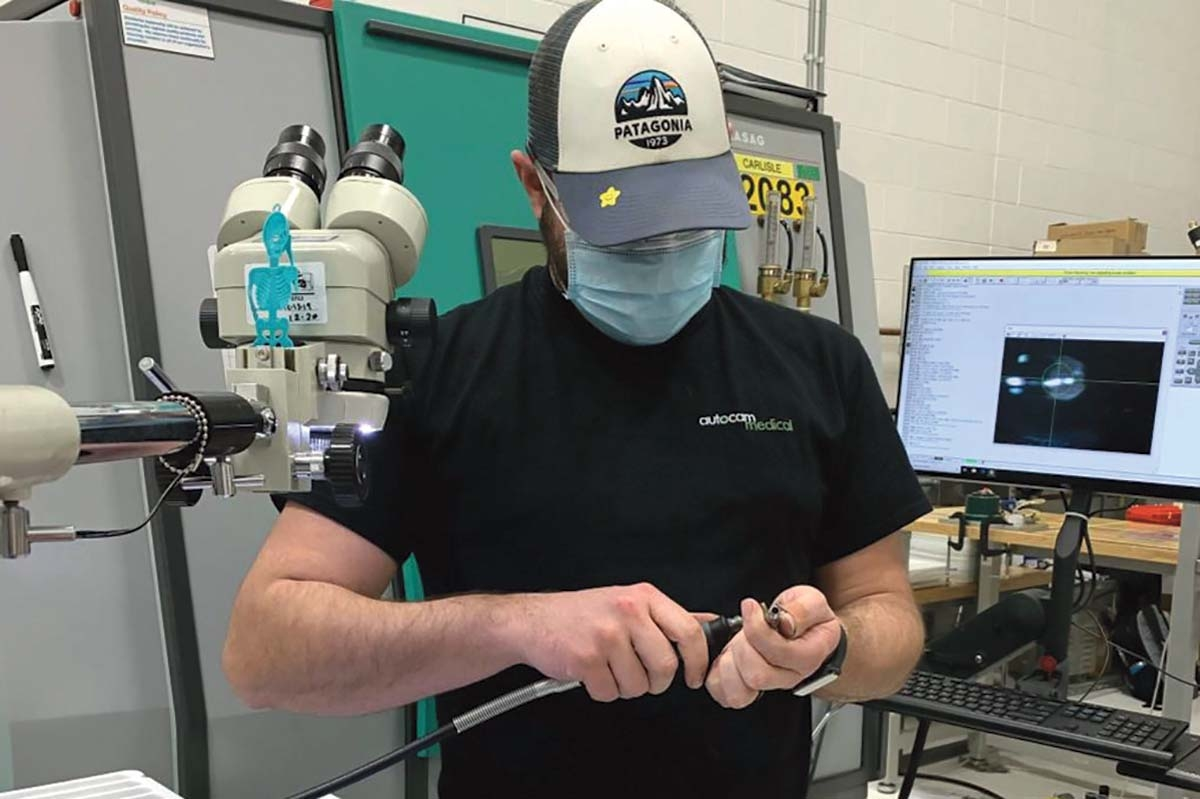 Workers at Autocam Medical Devices in Kentwood now wear face masks as part of safety measures taken in the wake of the COVID-19 outbreak.
