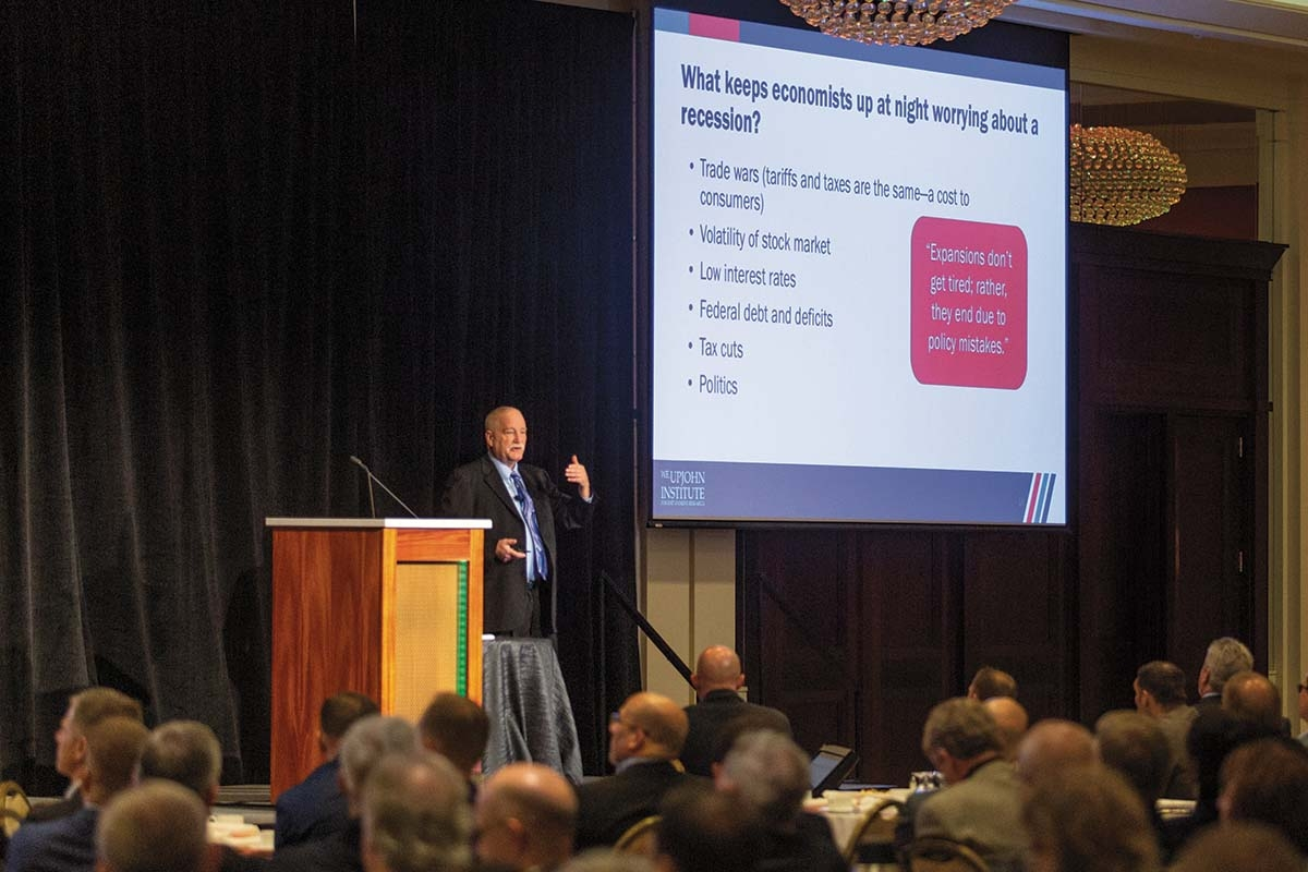 Jim Robey, director of regional economic planning services at the W.E. Upjohn Institute for Employment Research, discusses his projections for 2020 during The Right Place Inc.'s Economic Outlook event on Dec. 11 at the Amway Grand Plaza Hotel in Grand Rapids.