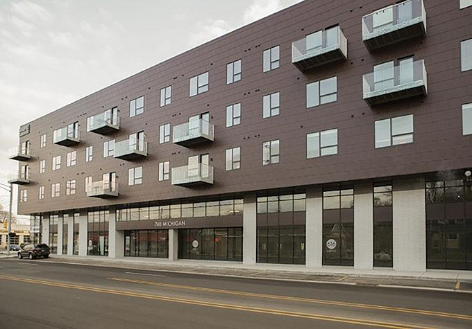 616 Development, a Grand Rapids-based real estate and property management firm, has forged a joint venture with a Mid-Michigan management company that executives say will allow it to grow into new markets and eventually add to its property holdings. Pictured is the company's 616 Lofts on Michigan property.