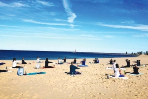 Muskegon-based Waters Edge Fitness has shifted to holding virtual classes or outdoor sessions, including on Pere Marquette Beach.