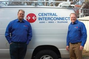 Wade Thompson, left, and Neil Brown, right, pose with one of the service vans that Central Interconnect uses to service customers throughout West Michigan.