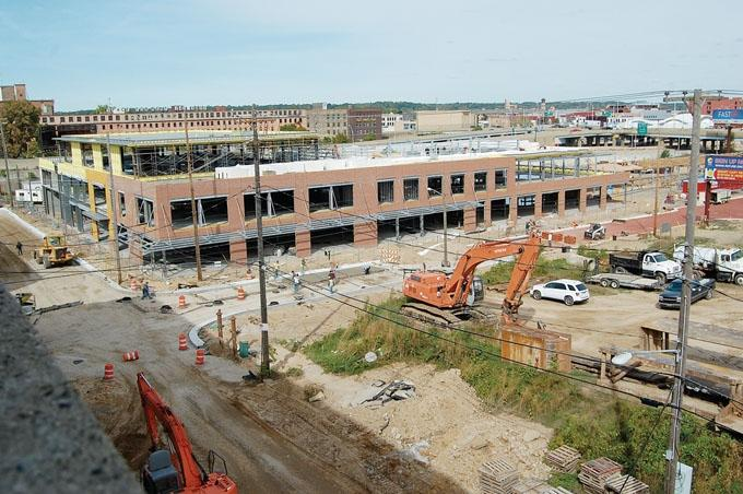 The Grand Rapids Downtown Market, shown here under construction, has restructured it debt related to a state economic development incentive.