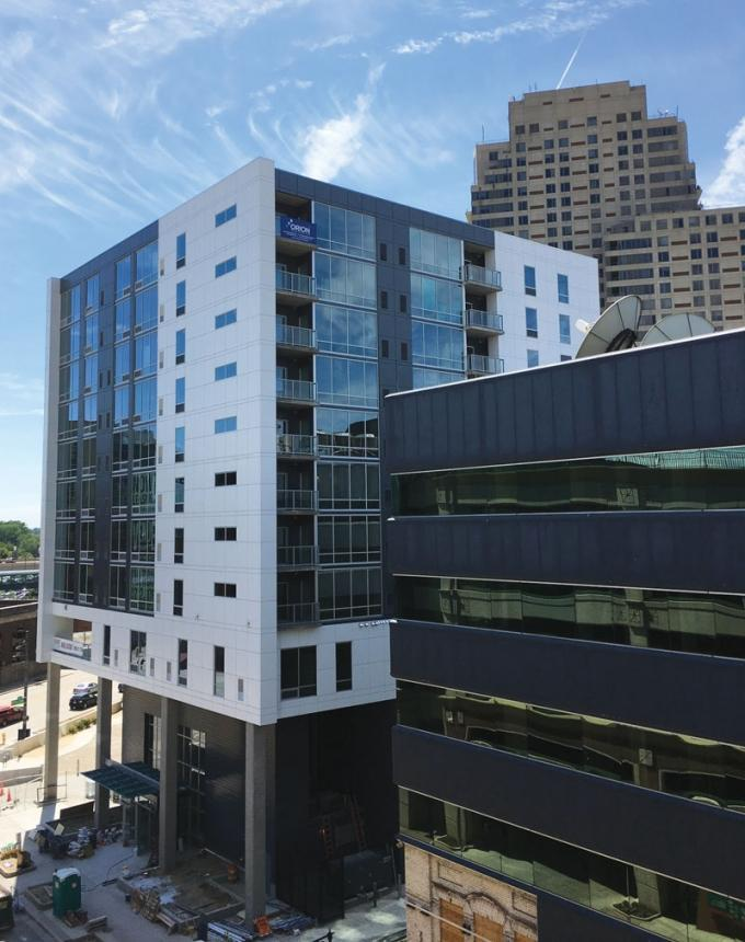 Orion Construction, which is building the Venue Tower project in downtown Grand Rapids, shown here, continues to find opportunities with mixed-use, urban housing projects. However, many firms are beginning to wonder if the current cycle for apartment developments could be coming to an end.