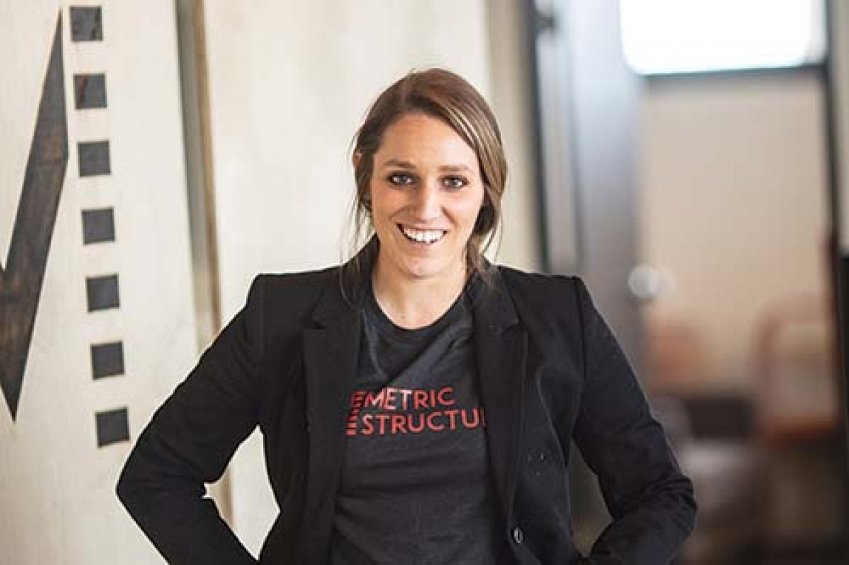 "Jacey Ehmann, founder and president of Metric Structures, a Grand Rapids-based construction firm, focuses on an inclusive work policy that's ""supportive instead of competitive."""