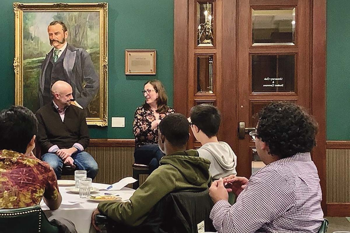 Corey Hart, director of the Grand Rapids chapter of Startup Grind, talks with Cara Fedewa Debbaudt, CEO and founder of BloomBright, during the group's meeting in November.