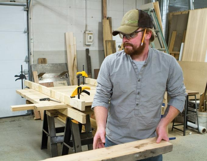 Daniel Chase started Re.dwell LLC to make furniture out of reclaimed wood from demolished houses, factories, barns and other found objects. The Grand Rapids-based company employs three people.