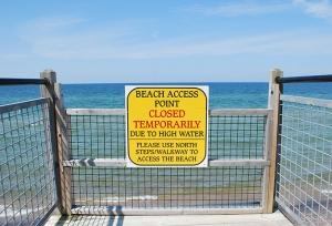 High water levels on Lake Michigan have reduced the amount of beach available to tourists, and have caused some damage at municipal-owned properties in high-erosion zones, according to Ottawa County Parks and Recreation Director John Scholtz. At Ottawa County's Rosy Mound Natural Area south of Grand Haven, shown here, the high water has led to some access point closures this summer.