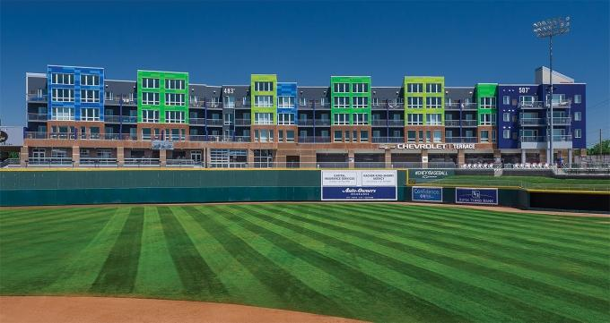 Developers from around the region have set their sights on the capital area with an influx of new mixed-use development projects. They include the Gillespie Group's Outfield development attached to Cooley Law School Stadium.