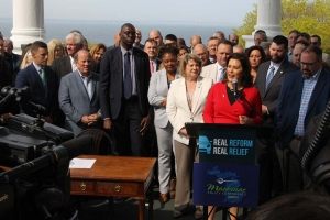 Gov. Gretchen Whitmer speaks at the Mackinac Policy Conference, where she signed Senate Bill 1 to reform Michigan's auto no-fault insurance system. Education reform was also a key issue at this year's conference.