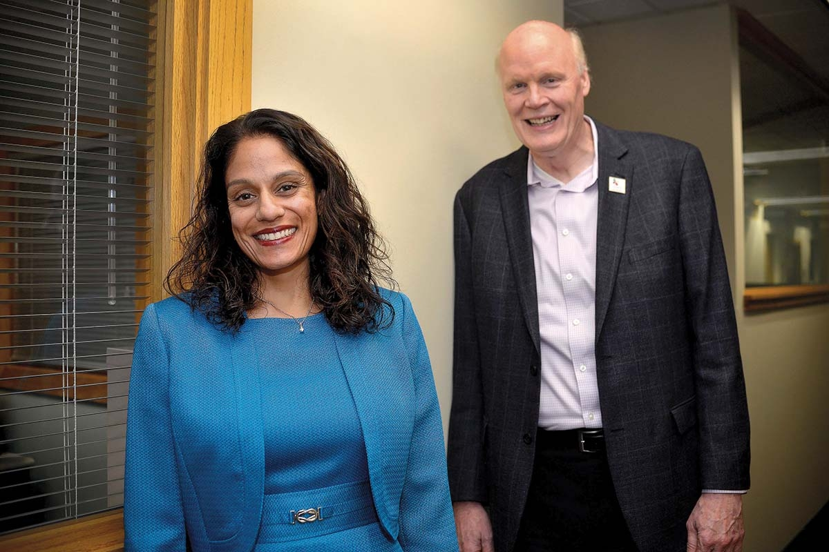 """Hope Network CEO Phil Weaver, right, said having Dr. Kiran Taylor, left, join as chief medical officer will allow the organization to """"talk to the doctors at the doctor level"""" when discussing new partnerships with medical care providers."""