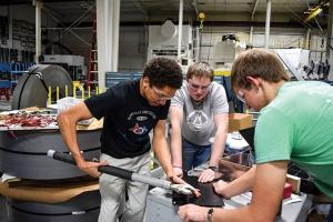 Preferred Tool and Die currently uses part of its space for a student robotics team, pictured above. Dubbed That ONE Team (Our Next Engineers), the group operates through First Robotics, a nonprofit organization dedicated to teaching young adults about robotics.