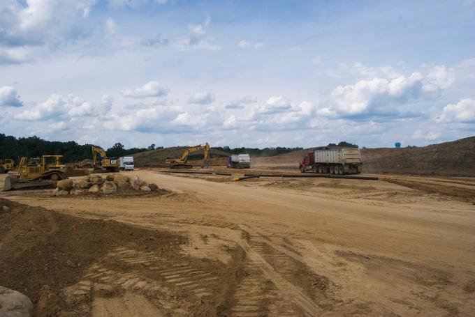 Crews work to clear ground for an expansion of the Fort Custer Industrial Park near Battle Creek.