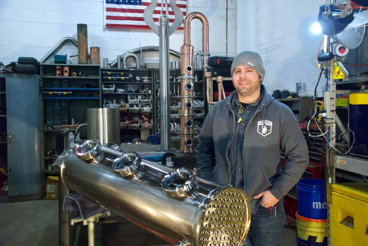 Scott Whitaker, owner of Muskegon-based NexGen Mechanical Solutions LLC, manufactures custom stills and other equipment for the distilling and brewing industry at his Getty Street shop.