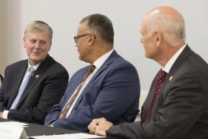 GVSU President Tom Haas, left, talks with WMU President Edward Montgomery, center, while WMed Dean Dr. Hal Jenson, right, looks on.