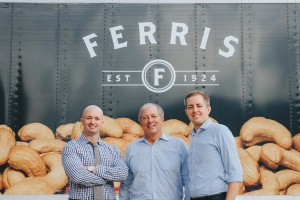 Ferris Coffee & Nut owner John Van Tongeren, center, is working with sons Mark, left, and David, right, to keep the business in the family after his eventual retirement.
