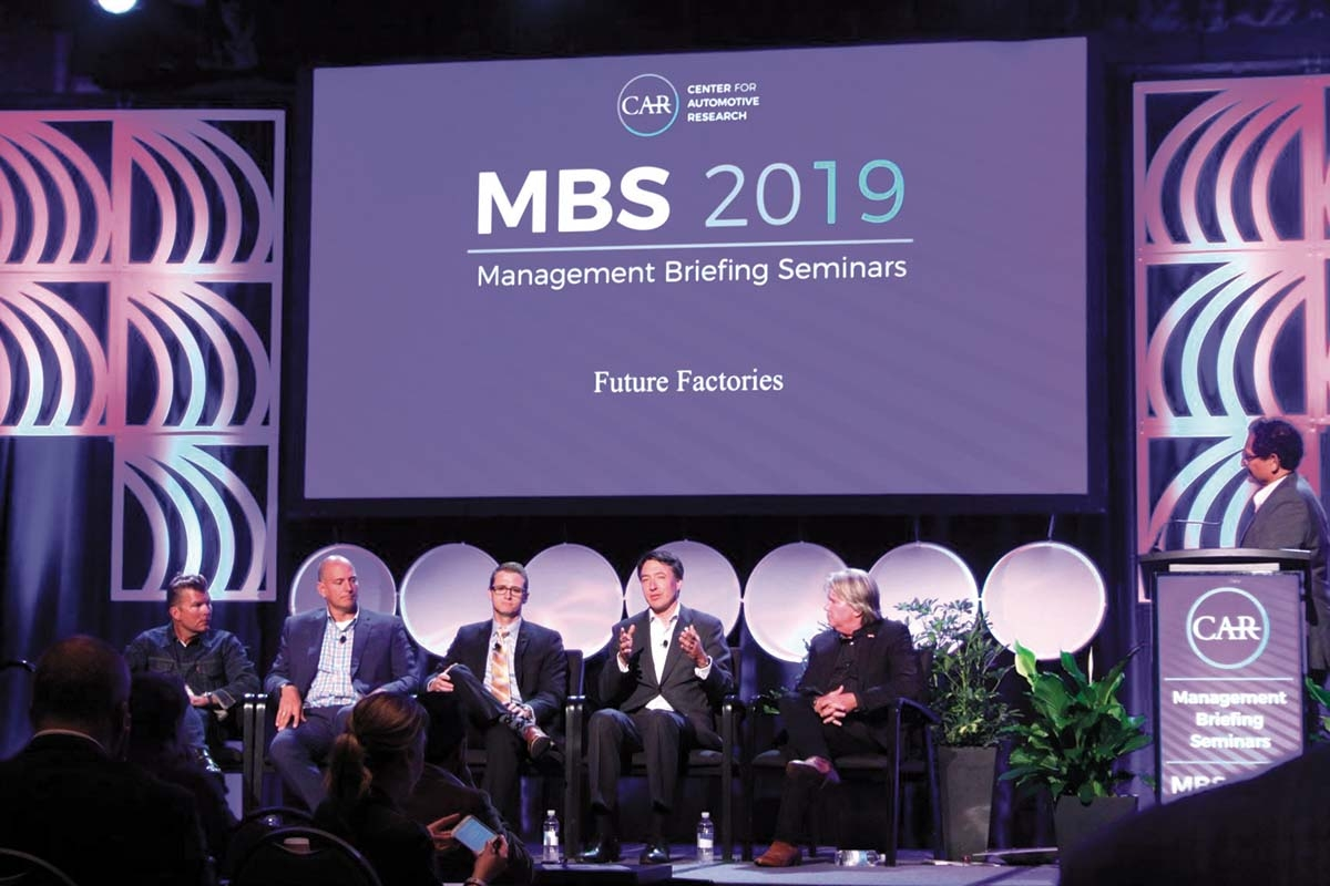 Panelists at the CAR Management Briefing Seminars look on as FACTON CEO Alexander Swoboda delivers a presentation on how disruptive technologies are affecting profitability for automotive suppliers.