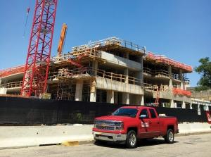 Brookstone Capital's 14-story apartment tower at 20 E. Fulton St. in Grand Rapids is one of the many projects keeping Pioneer Construction busy for the coming months. While executives say the short-term business prospects look promising, they're starting to be less certain about what the market will hold in the period 18 months from now.