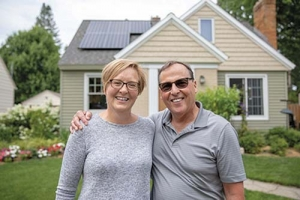 Holland residents Mary Cole, left, and Roy Cole, right, have used programs through the Holland Energy Fund to reduce their home's electricity usage by 60 percent.