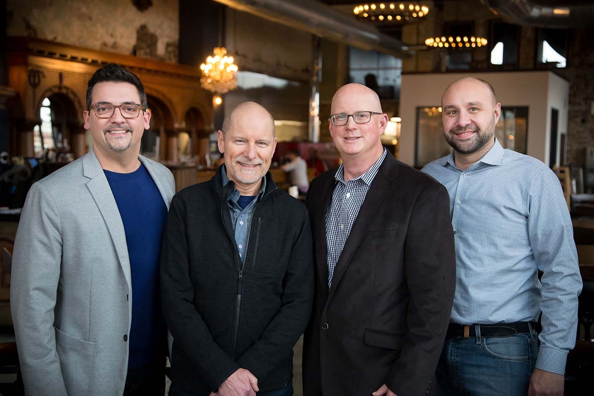 Revel has acquired Borns B2B. Pictured from left to right are Don Kalisz, Randy Borns, Jason Piasecki, Andy Maciejewski.