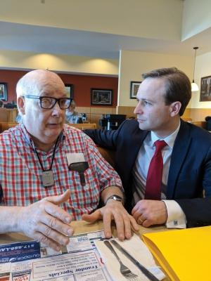Richard Prangley, left, and Michigan Lt. Gov. Brian Calley, right, discuss mental health issues. Prangley, who was institutionalized as a child, has been an outspoken advocate for the rights of developmentally disabled individuals over his 30-year career.