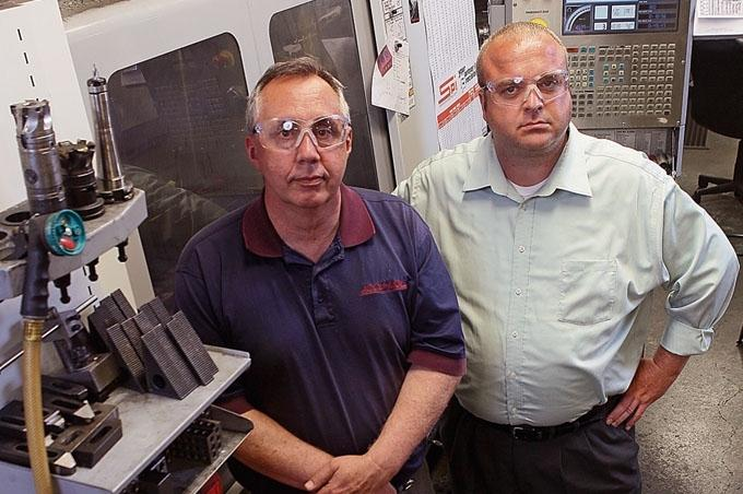 In 2013, former Accu-Mold President Dave Martin, right, sold his manufacturing and engineering company to Mno-Bmadsen, the business development arm of the Pokagon Band of Potawatomi that's led by Troy Clay, left. Now, Mno-Bmadsen hopes to certify Accu-Mold as a Native-owned business under the SBA's 8(a) program.