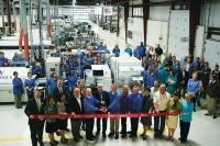 Workers at EBW Electronics Inc. celebrate an expansion project with a ribbon cutting in 2015. The Holland-based manufacturer of printed circuit boards has nearly doubled annual sales since 2012 and expects to grow further as it capitalizes on the growing market for LED lighting technology in the automobile industry.