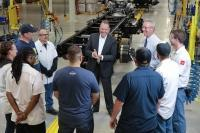During an annual analyst and investor presentation last week, Spartan Motors Inc. CEO Daryl Adams, at center, said the Charlotte-based heavy-duty vehicle manufacturer had been awarded a $214 million contract to make cargo delivery vans for the U.S. Postal Service.